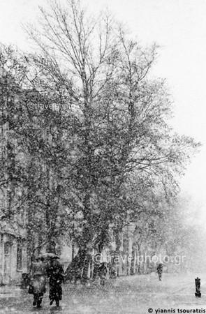 Acropolis, Athens, couple walking in snowfall